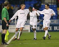 Photo. Aidan Ellis.<br />Bolton Wanderers v Aston Villa.<br />Carling Cup Semi Final 1st Leg.<br />21/01/2004<br />Bolton's Jay-Jay Okocha celebrates his wonder goal and Bolton's fifth with team mates Kevin Nolan and Youri Djorkaeff