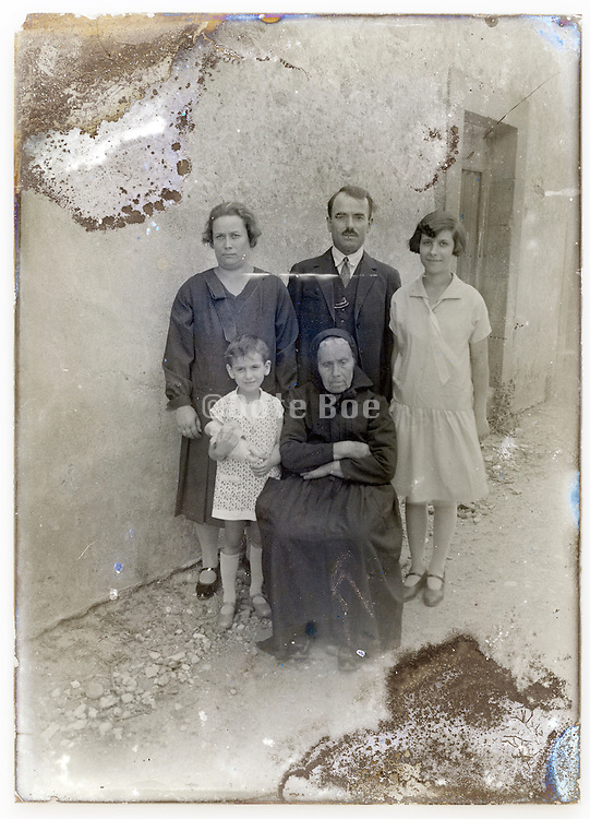 eroding glass plate with group family posing