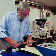 June 17, 2011. Alex Kennedy puts finishing touches on a model of the new gundalow.