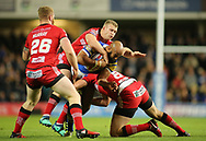 Jamie Jones-Buchanan (C) of Leeds Rhinos tackled by Salford Red Devils Daniel Murray, Joey Lussick and Craig Kopczak during the Super 8s Qualifiers match at Emerald Headingley Stadium, Leeds<br /> Picture by Stephen Gaunt/Focus Images Ltd +447904 833202<br /> 14/09/2018