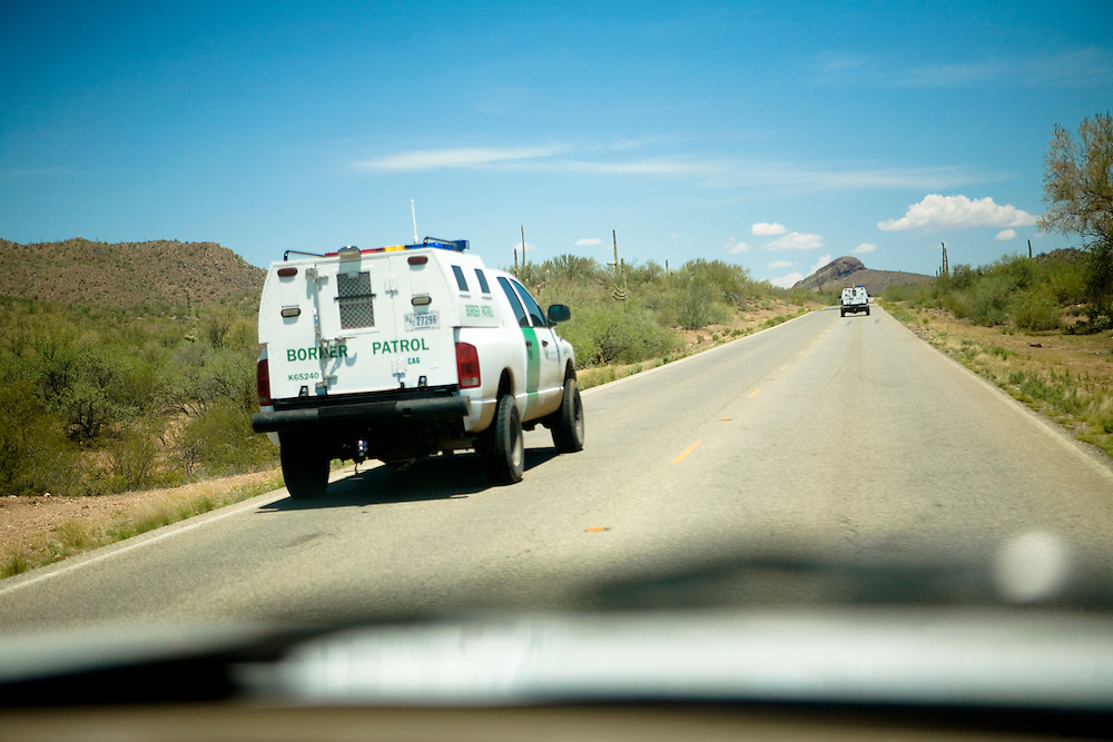 Two border patrol trucks drive through the Tohono O'odham reservation on Wednesday, July 16, 2008 near Sells, AZ.