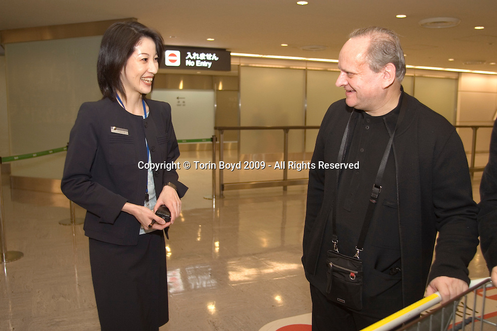 """This is Celebrity chef Joel Robuchon arriving Tokyo's Narita International Airport on February 6, 2009 and being greeted by his own Japan staff as well as representatives of """"2009 Tokyo Taste"""". The woman welcoming him is Miki Iwasawa, a representative of Air France at Narita. Robuchon traveled from his home base in Paris via Air France to attend an international food exposition called """"2009 Tokyo Taste"""". This three day event from February 9-11, 2009 showcases some of the world's most famous chefs including Robuchon and Ferran Adria (of El Bulli) who are both Honorary Advisors to this event. Other chefs participating in this event are Heston Blumenthal, Pierre Gagnaire, Jacques Puisais, Bruno Menard, Herve This, Ferran Adria, and Nobuyuki Matsuhisa to name a few. Robuchon also has restaurants in Tokyo and Nagoya Japan including; L'Atelier de Joel Robuchon and the prestigious Le Chateau de Joel Robuchon. These establishments are connected with Four Seeds Corporation, a Japanese corporation that owns and operates several popular restaurant chains around Japan."""