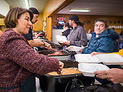 28 NOVEMBER 2019 - DES MOINES, IOWA: US Senator AMY KLOBUCHAR (D-MN), serves turkey at the South Des Moines Community Center. Sen Klobuchar served Thanksgiving lunches to people at the center. Sen. Klobuchar is campaigning to be the Democratic nominee for the US Presidency. Iowa holds the first selection event of the Presidential election cycle. The Iowa caucuses are Feb. 3, 2020.               PHOTO BY JACK KURTZ