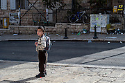 A young boy with his school backpack in the Mea Sharim neighborhood of Jerusalem