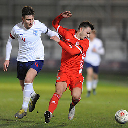 19/3/2019 - Henry Jones(Bala) battles for the ball with  Laurence Maguire (Chesterfield) during the C International between England and Wales at the Peninsula Stadium, Salford.<br /> <br /> Pic: Mike Sheridan/County Times<br /> MS023-2019