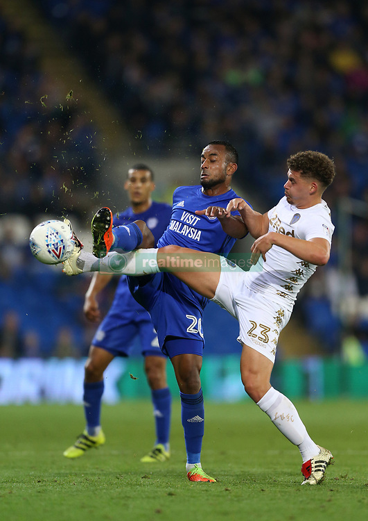 Cardiff City's Loic Damour (left) and Leeds United's Kalvin Phillips battle for the ball during the Sky Bet Championship game at the Cardiff City Stadium.