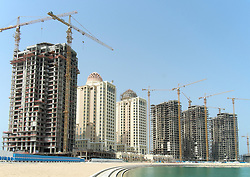 New apartment tower under construction at new Pearl Doha land reclamation property development area in Doha Qatar