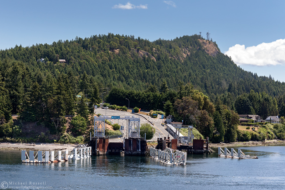 The Village Bay Terminal on Mayne Island, British Columbia, Canada. Heck Hill is in the peak in the background.