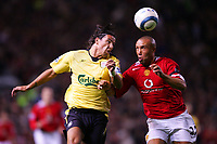 MANCHESTER, ENGLAND - MONDAY SEPTEMBER 20th 2004: Liverpool's Milan Baros and Manchester United's Mikael Silvestre during the Premiership match at Old Trafford. (Photo by David Rawcliffe/Propaganda)