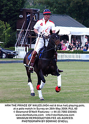 HRH THE PRINCE OF WALES (NO4 red & blue hat) playing polo, at a polo match in Surrey on 26th May 2004.PUL 60