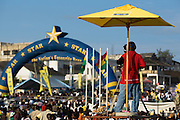 A television cameraman films from an elevated platform during the annual Oguaa Fetu Afahye Festival in Cape Coast, Ghana on Saturday September 6, 2008.