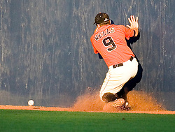 Oregon State Beavers OF Braden Wells (9) hits the outfield wall as the ball lands on the warning track.  The Oregon State Beavers defeated the Virginia Cavaliers 5-3 in Game 6 of the NCAA World Series Charlottesville Regional held at Davenport Field in Charlottesville, VA on June 4, 2007.