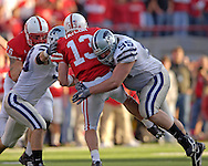 Kansas State defensive tackle Derek Marso (95) sacks Nebraska quarterback Zac Taylor (13) in the seceond half.  Nebraska defeated Kansas State 27-25 at Memorial Stadium in Lincoln, Nebraska, November 12, 2005.
