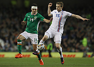 John Egan of Republic of Ireland and Jon Dadi Bodvarsson of Iceland during the International Friendly match at the Aviva Stadium, Dublin<br /> Picture by Lorraine O'Sullivan/Focus Images Ltd +353 872341584<br /> 28/03/2017