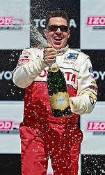 LONG BEACH, CA - APR 14: American radio personality, television host, comedian, and actorAdam Carolla celebrates after winning the 2012 Toyota Celebrity/PRO Race in Long Beach, CA. All fees must be ageed prior to publication,.Byline and/or web usage link must  read SILVEX.PHOTOSHELTER.COM . Photo by Eduardo E. Silva