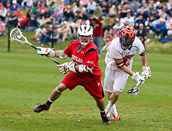 Maryland Terrapins Midfield Rob Morrison (6) in action against UVA. The #9 ranked Maryland Terrapins fell to the #1 ranked Virginia Cavaliers 10 in 7 overtimes in Men's NCAA Lacrosse at Klockner Stadium on the Grounds of the University of Virginia in Charlottesville, VA on March 28, 2009.