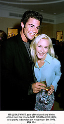 MR LUKAS WHITE, son of the late Lord White of Hull and his fiance MISS NORMANDIE KEITH, at a party in London on November 5th 1996.                              LTG 114