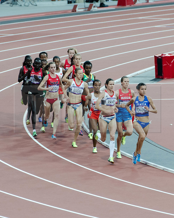 © Licensed to London News Pictures. 10/08/2012. London, UK.  The Women's 5000m final at the Olympics London 2012. Italian Elena Romagnolo takes the lead from Team GB Jo Pavey.  Photo credit : Richard Isaac/LNP