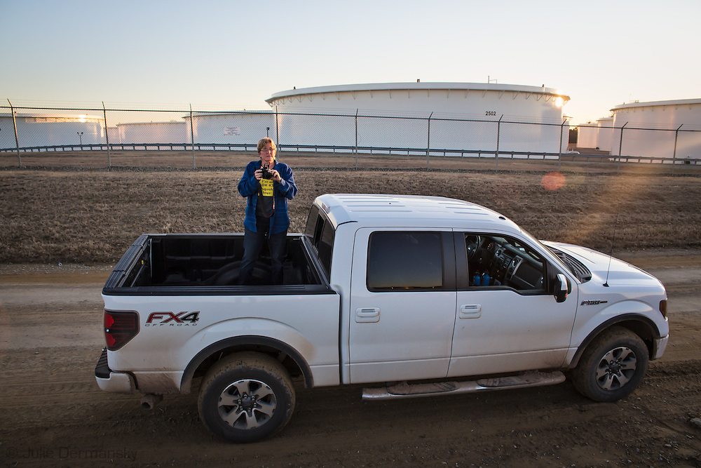 1/13/2016, Angela Spotts, the founder of Stop Fracking Payne County and a Stillwater homeowner taking photos in Cushing, Oklahoma. Spotts is an anti-fracking activist who share information on the fracking industry with concerned citizens and the media.