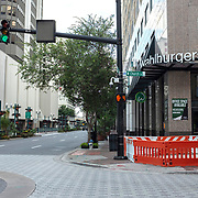 City streets and sidewalks remain vacant during the afternoon rush hour due to the Coronavirus (Covid-19) outbreak on Tuesday, July 14, 2020 in Orlando, Florida. There are  292,000 confirmed positive cases in Florida according to the Florida Department of Health with a current death toll of 4,409. (Alex Menendez via AP)