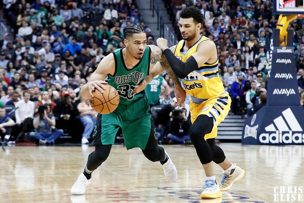 10 March 2017: Denver Nuggets guard Jamal Murray (27) defends on Boston Celtics forward Gerald Green (30) during the Denver Nuggets 119-99 victory over the Boston Celtics, at the Pepsi Center, Denver, Colorado, USA.