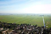 Nederland, Utrecht, Bikkerspolder, 28-06-2006; een van de laatste open veenweide landschappen in de Noordoostelijke Randstad, polders tussen Bunschoten-Spakenburg en Eemnes, direkt ten Noorden van autosnelweg A1; aan de horizon de randmeren (Eemmeer) met windmolens in Flevoland;  .luchtfoto (toeslag); aerial photo (additional fee required); .foto Siebe Swart / photo Siebe Swart