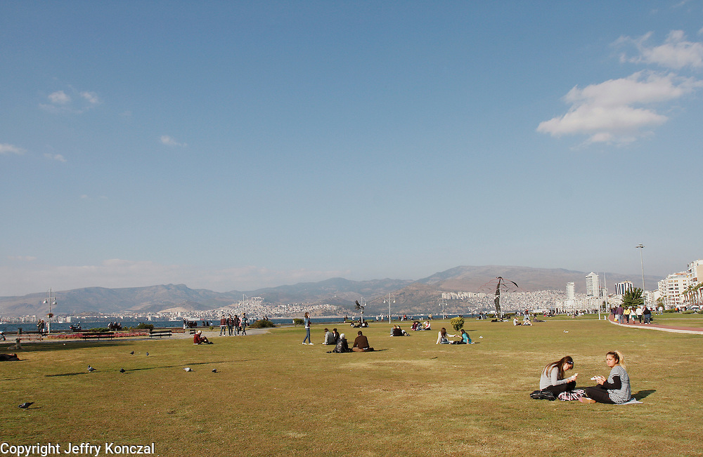 People relax on green space in Izmir, Turkey.
