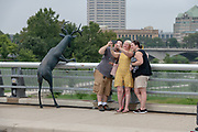 Deer sculpture on the Rich Street bridge, looking at downtown Columbus, Ohio.