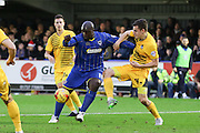 Despite being a man down for the most the half, AFC Wimbledon still put on pressure with Bayo Akinfenwa of AFC Wimbledon during the Sky Bet League 2 match between AFC Wimbledon and Bristol Rovers at the Cherry Red Records Stadium, Kingston, England on 26 December 2015. Photo by Stuart Butcher.