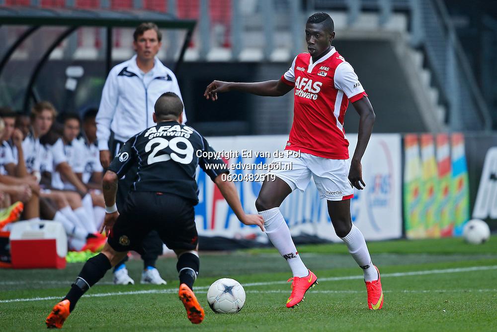 ALKMAAR - 04-09-2014 - AZ - KV Mechelen, oefenduel, AFAS Stadion, 2-1, AZ speler Derrick Luckassen (r), KV Mechelen speler Cordaro Alessandro (l).