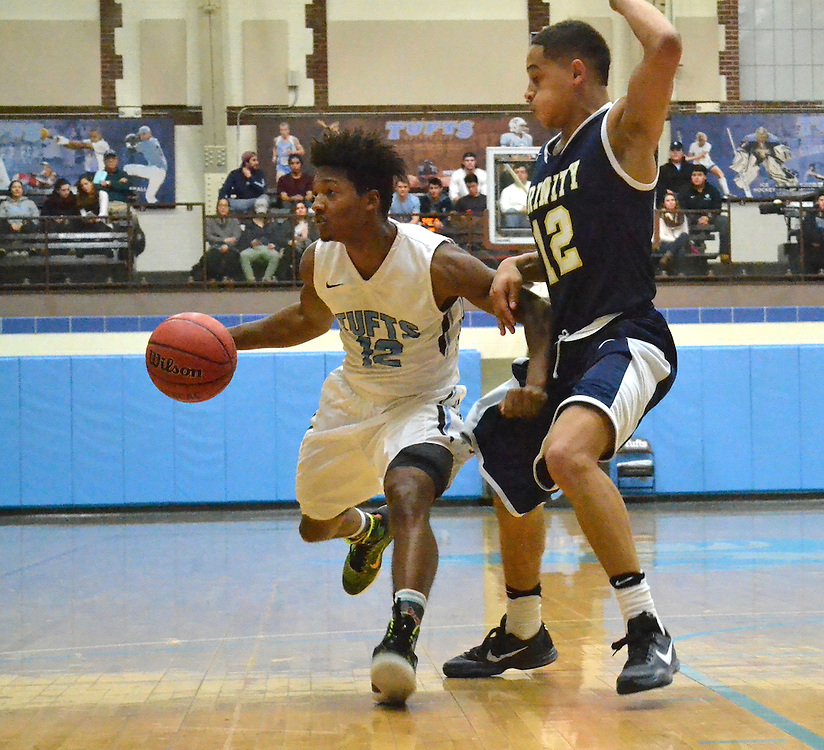 2/5/16 – Medford/Somerville, MA – Tufts guard Tarik Smith, A17, runs the ball down the court in the men's basketball game against Trinity on Feb. 5, 2016. (Laura de Armas / The Tufts Daily)