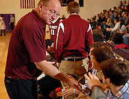 6 JAN. 2012 -- TOWN & COUNTRY, Mo. -- DeSmet Jesuit High School assistant coach John Stewart congratulates the Spartan bench during the Metro Catholic Conference game between DeSmet an CBC High School at CBC in Town & Country, Mo. Friday, Jan. 6, 2012. The Spartans won the match, 64-42. Photo © copyright 2012 by Sid Hastings.