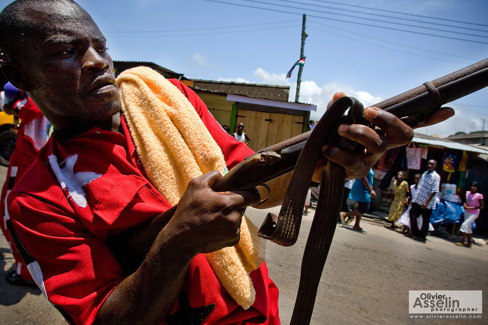 A man from the #1 Asafo company holds up a ceremonial rifle during a parade held on the occasion of the annual Oguaa Fetu Afahye Festival in Cape Coast, Ghana on Saturday September 6, 2008.
