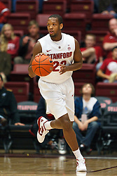 Nov 28, 2011; Stanford CA, USA;  Stanford Cardinal guard Gabriel Harris (23) dribbles the ball up court against the Pacific Tigers during the second half at Maples Pavilion. Stanford defeated Pacific 79-37. Mandatory Credit: Jason O. Watson-US PRESSWIRE