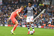 West Bromwich Albion midfielder (on loan from Sporting Lisbon) Matheus Pereira (12) battles for possession  with Huddersfield Town defender Florent Hadergjonaj (33) during the EFL Sky Bet Championship match between West Bromwich Albion and Huddersfield Town at The Hawthorns, West Bromwich, England on 22 September 2019.