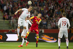 October 8, 2017 - Warsaw, Poland - Kamil Glik of Poland jumps for the ball with Mirko Ivanic of Montenegro during the FIFA World Cup 2018 Qualifying Round Group E match between Poland and Montenegro at National Stadium in Warsaw, Poland on October 8, 2017  (Credit Image: © Andrew Surma/NurPhoto via ZUMA Press)
