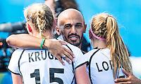 RIO DE JANEIRO  -  coach Jamilon Mulders (Ger) with Hannah Kruger (Ger) and Nike Lorenz (Ger)   after the quarterfinal   hockey women USA-Germany (0-2). COPYRIGHT KOEN SUYK