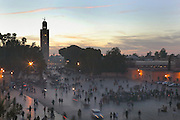 Entrance to Djemma el Fna square and marketplace with minaret of Koutoubia mosque in the background, evening, Medina, Marrakech, Morocco. Picture by Manuel Cohen