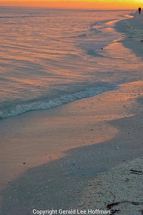 Sunset walk on Sanibel Island beach, Florida.