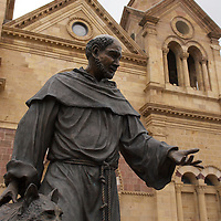 Statue of St. Francis of Assisi by Betty Sabo in front of cathedral in Santa Fe.