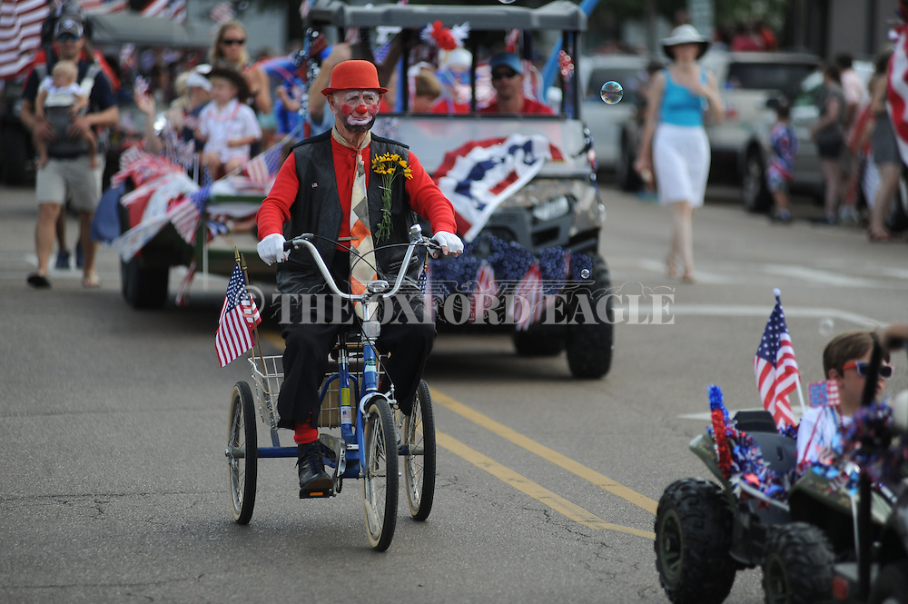 John Arrechea rides in a 4th of July parade in Oxford, Miss. on Monday, July 4, 2016. (Bruce Newman, Oxford Eagle via AP)