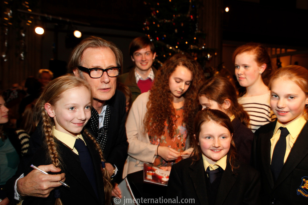 Bill Nighy signing autographs, Nordoff Robbins Carol Service  2011 sponsored by Coutts. London..Wednesday, 14. Dec 2011