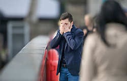 © Licensed to London News Pictures. 05/06/2017. London, UK. A man is overcome with grief after placing a floral tribute on London Bridge following a terrorist attack on Saturday evening. Three men attacked members of the public after a white van rammed pedestrians on London Bridge. Ten people including the three suspected attackers were killed and 48 injured in the attack. Photo credit: Peter Macdiarmid/LNP
