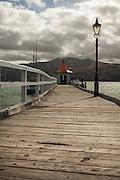 Pier along Akaroa Bay, Banks Peninsula, New Zealand