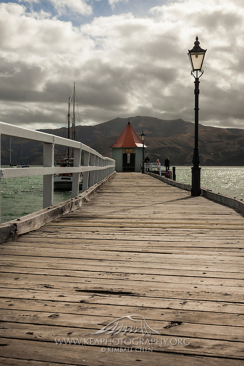 Pier along Akaroa Bay, Banks Peninsula, New Zealand
