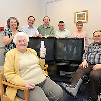 29.04.2012 .The Harvest Committee, who have been fundraising for Jewish Care's Vi and John Rubens House in Ilford for 40 years. They have raised a total of £40,000 for items needed by the residential care home. Pictured with two of the televisions they have donated. Pictured is Vi and John Rubens resident Fay Armstrong, 92, with the committee (L-R) Miriam Granby, Jonathon Benton, Melvyn Zussman, Dereck Goldberg, Susan Zussman and (seated) Chairman Stephen Sklayne. .Mandatory Credit: © Blake Ezra Photography.www.blakeezraphotography.com