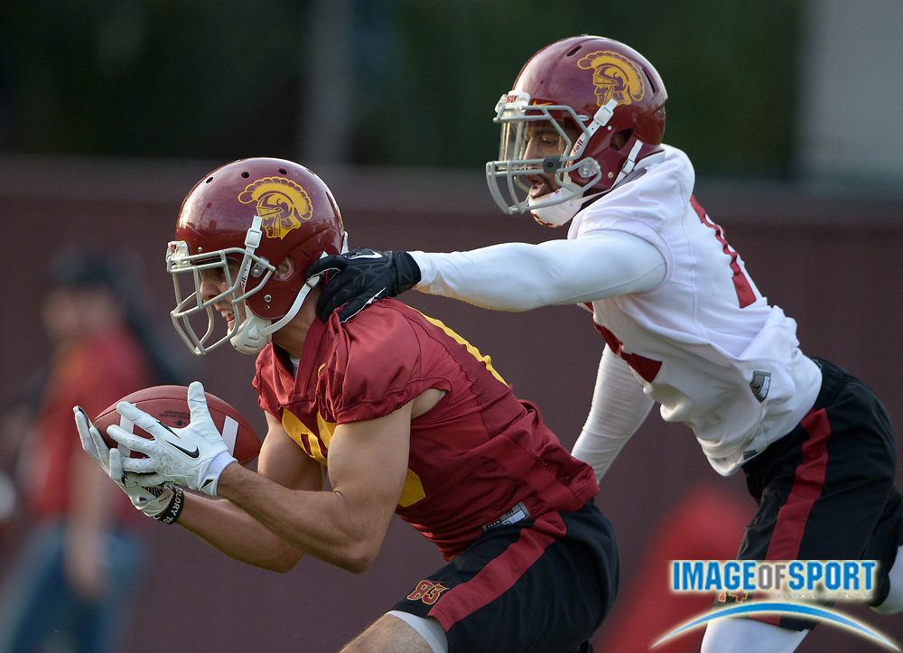 Mar 11, 2014; Los Angeles, CA, USA; Southern California Trojans receiver Christian Tober (28) is defended by cornerback Ryan Henderson (14) at spring practice at Howard Jones Field.