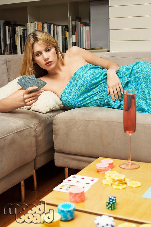 Woman lying on sofa Playing Cards
