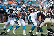 Christian McCaffrey(22) follows his blockers in the New Orleans Saints 34 to 13 victory over the Carolina Panthers.