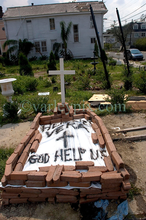 05 Sept  2005. New Orleans, Louisiana. Post hurricane Katrina.<br /> 'Here lies Vera - God help us.' The temporary grave of a resident of Uptown New Orleans lies at the crossroads of Magazine Street and Jackson Street in the ghost town that once was New Orleans.<br /> Photo; &copy;Charlie Varley/varleypix.com